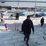 Man walking backwards reversed